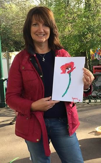 Photo: Lynn showing off her Paint A Poppy painting